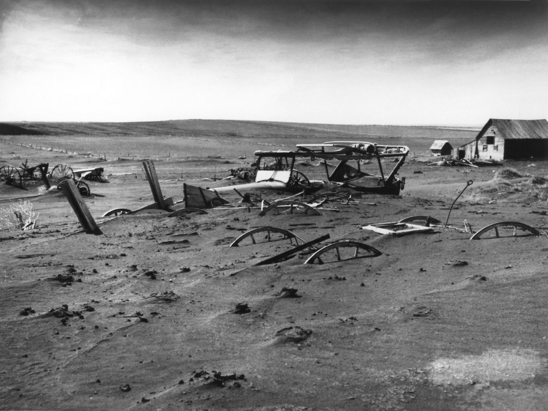 Dust buries a South Dakota farm in 1936. Wikimedia Commons